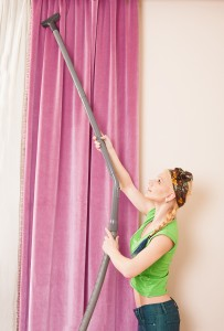 Using a vacuum cleaner to clean curtains